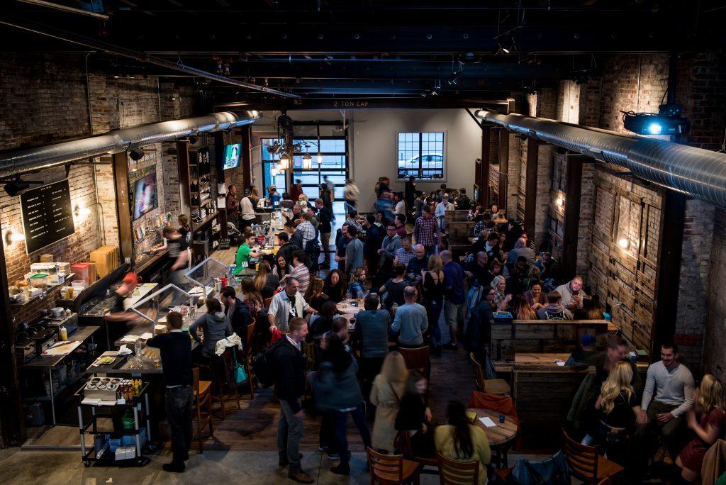 Crowd enjoys bar at Evil Genius brewery